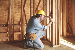 construction worker building a custom home