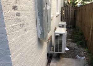 Two Small Outside Compressor & Condenser Units In One Of Our Historic Home Remodels